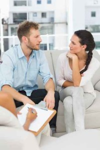 Unhappy couple talking at therapy session